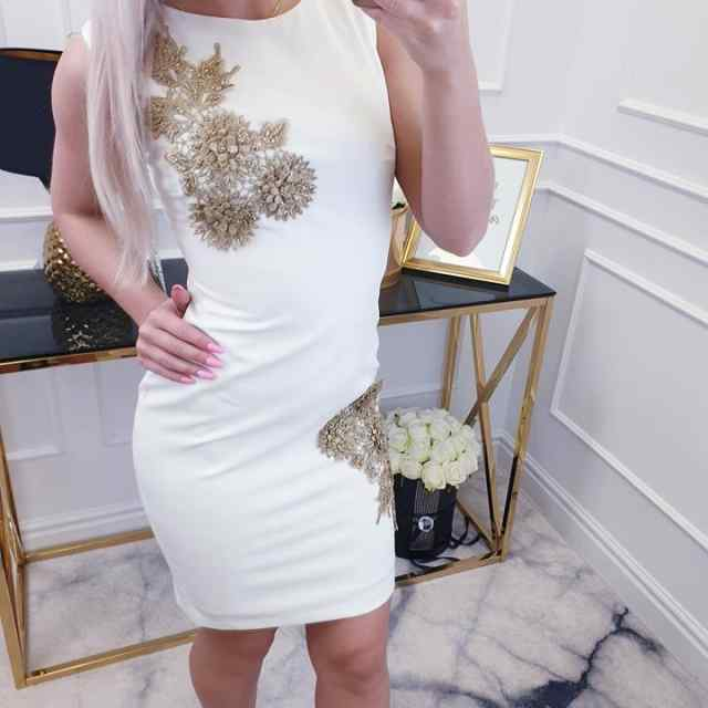 Kvaliteetne kaunistusega kleit
