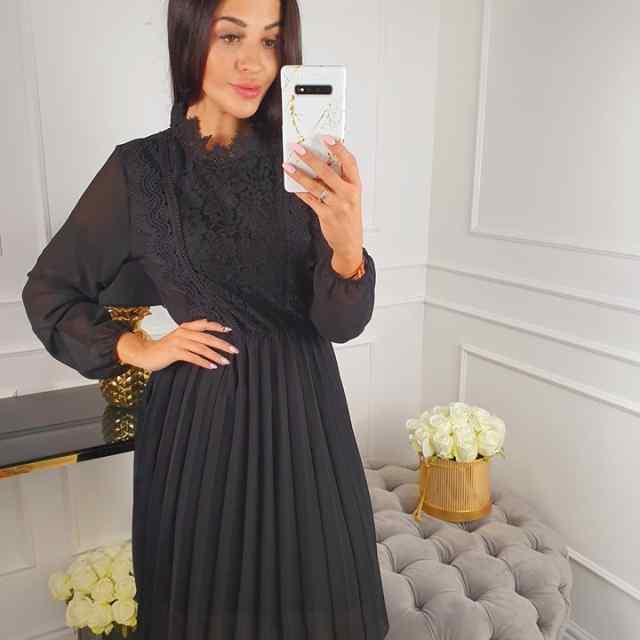 Kvaliteetne plisseeritud seelikuosaga kleit