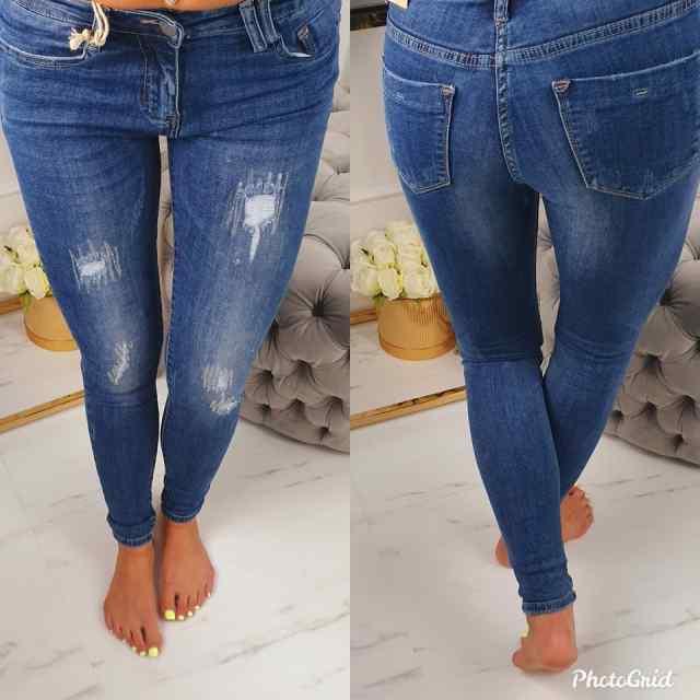 Kvaliteetsed kulutatud teksapüksid, kaunistusega