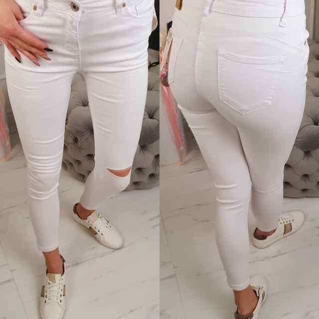 Kvaliteetsed mugavad lõhkise põlvega teksapüksid, sobivad lühemale