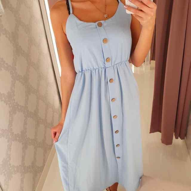 Eest nööpidega õhemast kangast pikem kleit