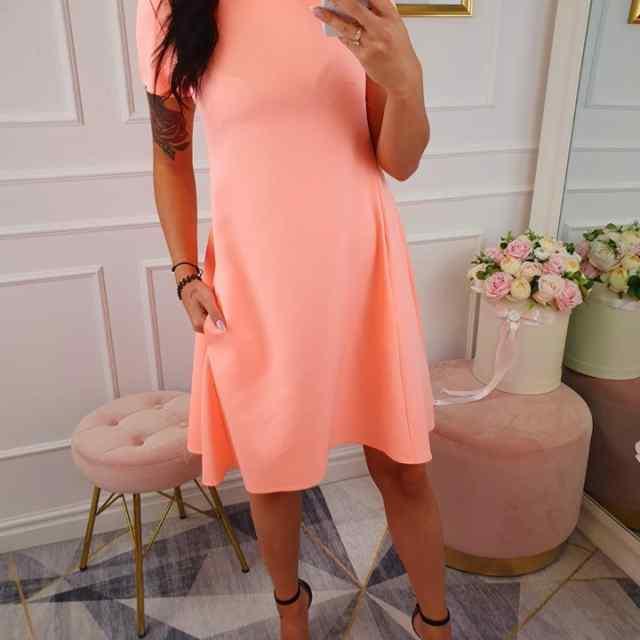 A-lõikeline taskutega kleit