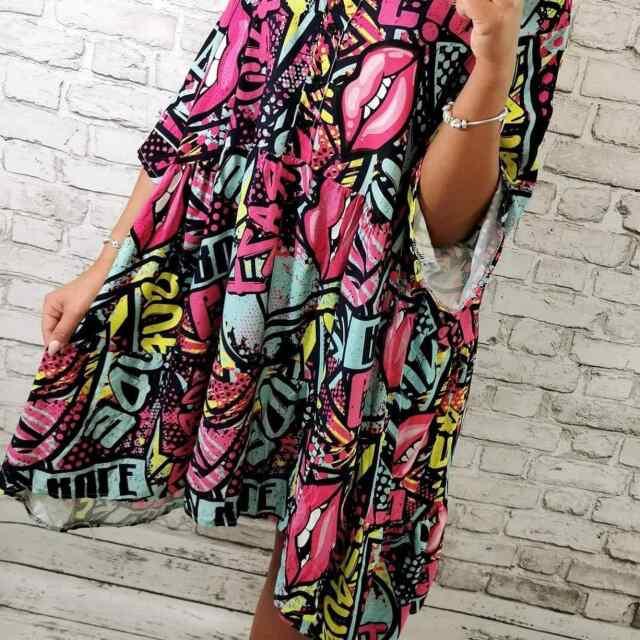 Langeva lõikega kirju kleit